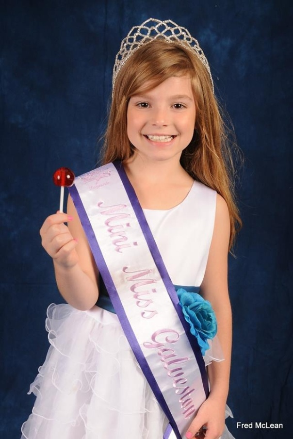 ​Forever Beautiful Mini Miss Galveston, Kadence Bryan enjoying her lollipop after capturing her title