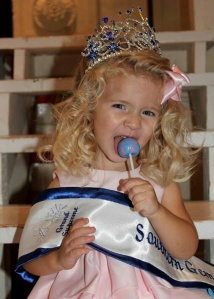 Annalyse Wright, Southern Gems Grand Supreme winner enjoying her Cotton Candy flavored Original Gourmet Lollipop. Annalyse is 2 years old
